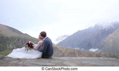 Man hugging women on the background of mountains