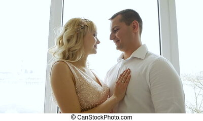 man husband embracing belly of his pregnant wife in dress...