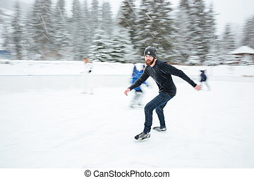 Man ice skating outdoors