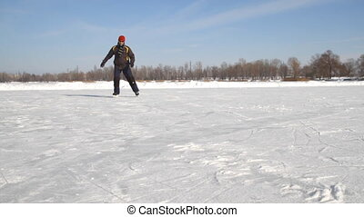Man Ice skating on a frozen lake