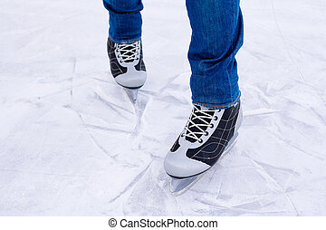 Man ice skating. winter outdoors on ice rink.