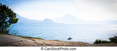 Man in a boat on a lake in Guatemala