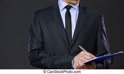 man in a business suit with a tablet