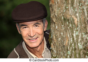 Man in a cap in a forest