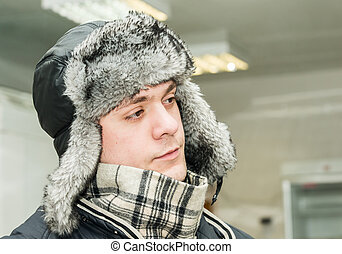 man in a cap with earflaps