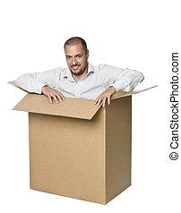 Man in a cardboard box.