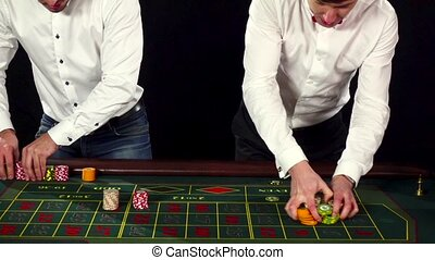 Man in a casino lose on the roulette. Black