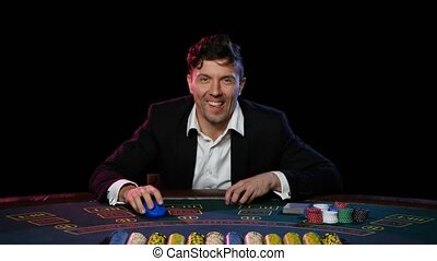 Man in a casino play in online poker and lose. Close up