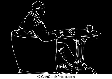 man in a chair drinking tea in a cafe