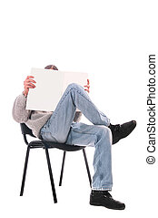 man in a chair with a magazine