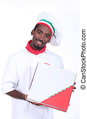 Man in a chef's outfit with a pizza box