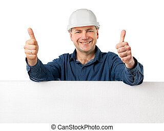 man in a construction helmet holding big white board