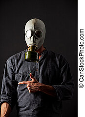 man in a gas mask on black background