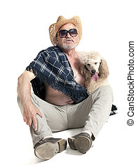 Man in a hat sitting with a poodle