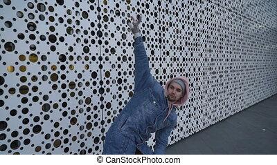 Man in a hood is dancing