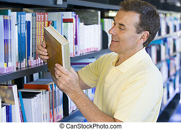 Man in a library reading book cover