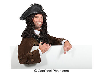 Man in a period highwayman costume with a board blank for your message