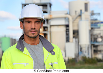 Man in a reflective jacket on site