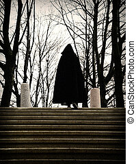 man in a robe climbing stairs
