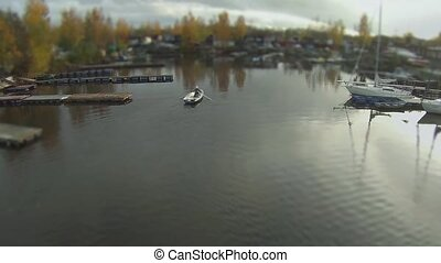 man in a rowing boat aerial view - Flying over the rowing ...