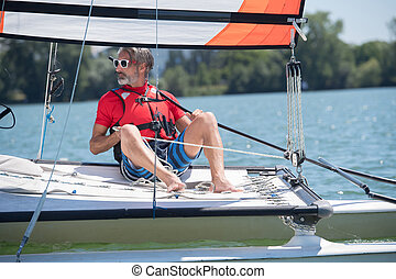 man in a sailing vessel
