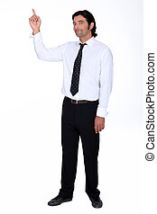 Man in a shirt and tie pointing upwards