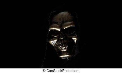 Man in a skeleton mask in the dark - Death in the hood in ...