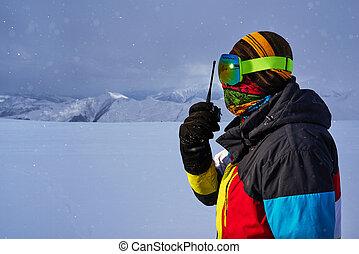 man in a ski mask says on radio