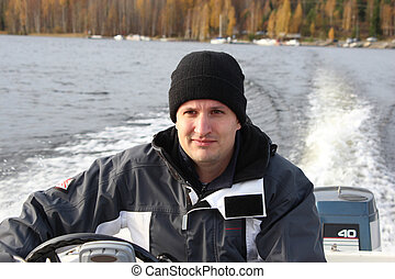 Man in a small power boat 2