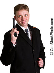 man in a suit aims from a pistol