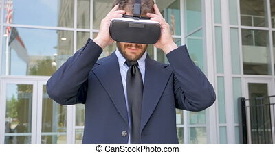 Man in a suit leaves virtual reality disappointed removing his VR headset