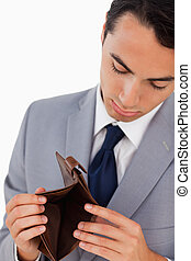 Man in a suit showing his empty wallet