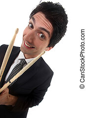 Man in a suit with drum sticks