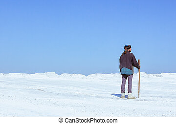 Man in a turban among the white desert