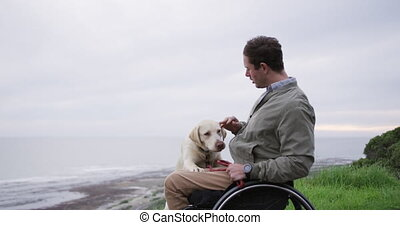 Man in a wheelchair spending time with his dog