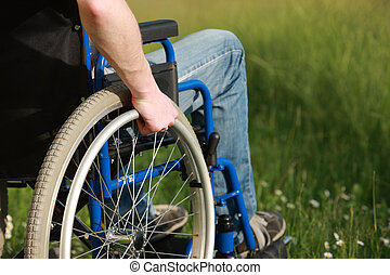 Man in a wheelchair - Close up of a man in a wheelchair in...