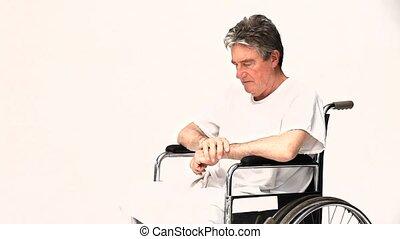 Man in a wheelchair waiting for his nurse