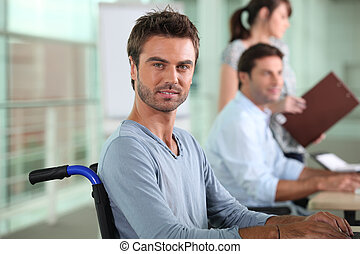 Man in a wheelchair working in an office