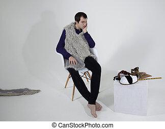 man in a white chair