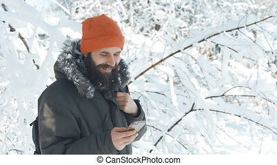 Man in a winter snowy day talking on mobile phone