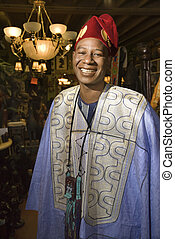 Man in African costume. - Portrait of smiling mid-adult...
