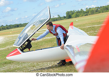 Man in airfield with glider