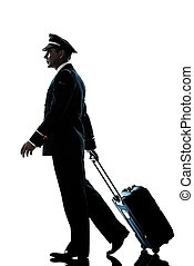 man in airline pilot uniform silhouette walking - one...