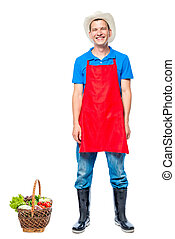Man in apron farmer with basket of vegetables on white background