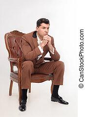 Man in armchair