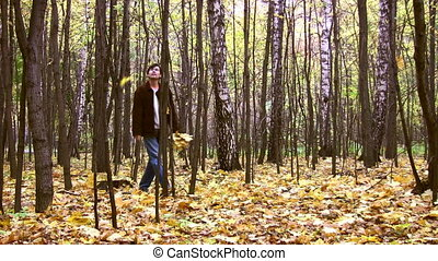 man in autumnal wood