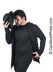 Man in black dancing with hat