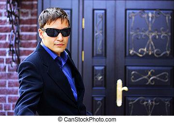 Man in black glasses