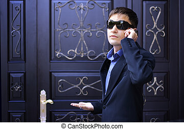 Man in black glasses talking on the phone