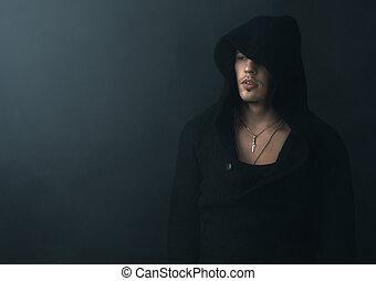 man in  black hoodie upset - man in a black hoodie upset